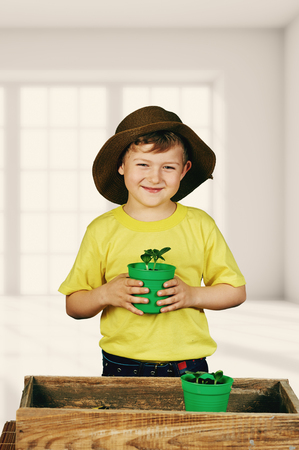 child protection: the boy planting the seedlings. Fun little gardener.