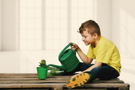the boy planting the seedlings. Fun little gardener.
