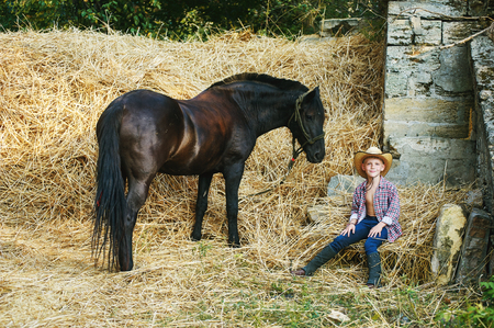 The boy resting on the hay in a summer day Stock Photo