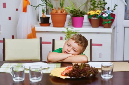 sad boy at Breakfast .Lack of appetite Stock Photo