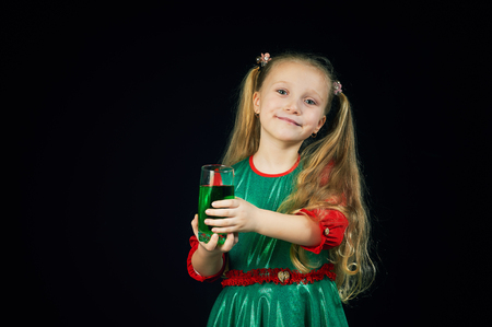 Girl holding a glass of green drink on St. Patrick's day