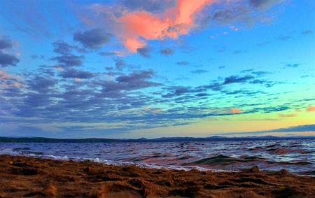 Beautiful sunrise on the lake in windy weather