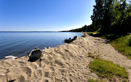 quiet lake Uvildy early in the morning, clear water, clear bottom,sandy beach, South Ural
