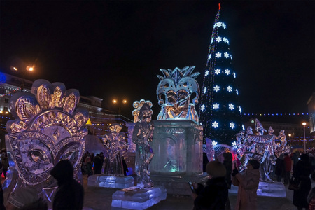 Christmas tree and ice figures in the city square