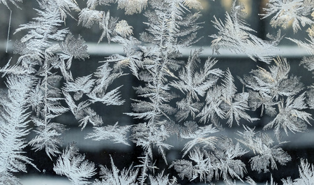 lines, frosty patterns on the window glass, texture of frosty patterns