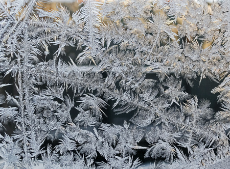 texture of frosty patterns on the window glass, winter background