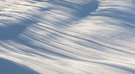 texture fresh snowdrift illuminated by the sun with blue wavy shadows Banco de Imagens