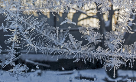 beautiful frosty patterns on glass