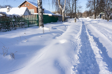 winter road covered with fresh snow in the countryside, southern Urals