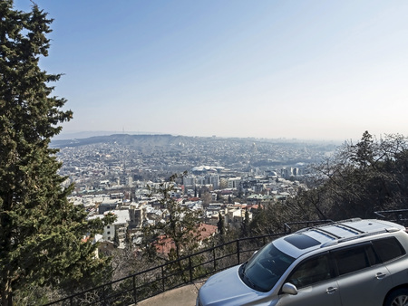 view of Tbilisi from above from the Holy mountain on a Sunny spring morning Banco de Imagens