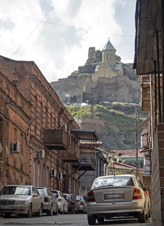 sloping streets of old Tbilisi, in the distance you can see Narikala fortress