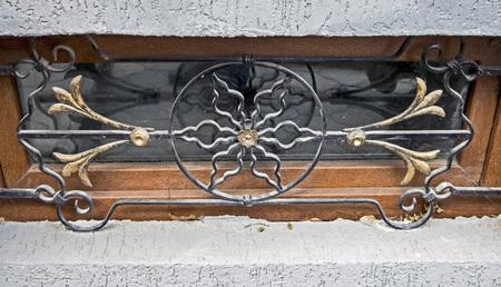 twisted metal fence basement window in Georgia Foto de archivo