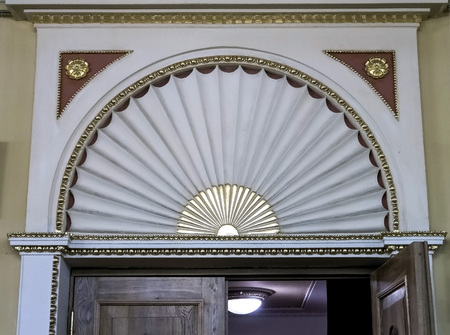 classic design of the top above the entrance to the auditorium in the theater Banco de Imagens