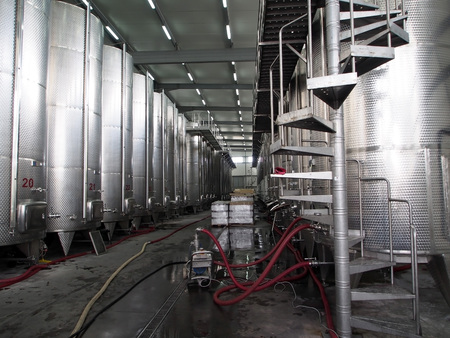 room for wine production at the winery, the rows are wine tanks Banco de Imagens