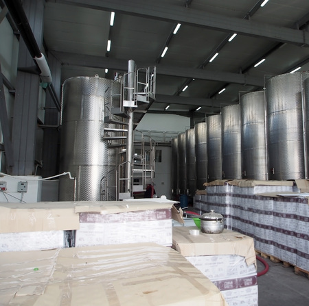 in the production shop of the winery in Georgia are tanks for wine