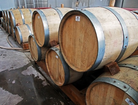 oak barrels with ready-to-ship cognac at a wine factory in Georgia Banco de Imagens
