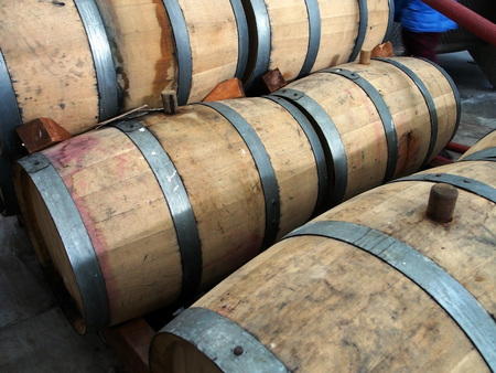 stacked oak barrels for cognac at a winery in Georgia