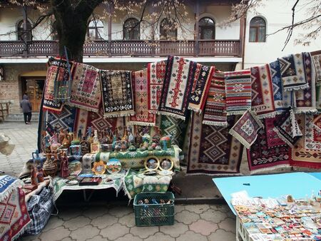 small street trade on the street of a small Georgian town, woolen knitted things, Souvenirs, carpets