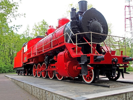 red old steam locomotive, the car is more than 100 years old