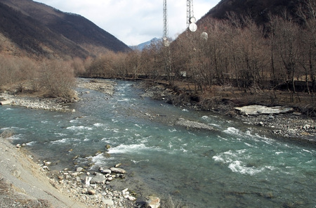 Aragvi mountain river flows in a valley in Georgia among the beautiful scenery