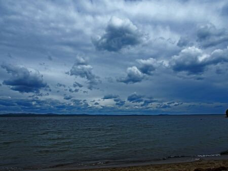 heavy gray clouds over the lake on a cloudy evening, the southern Urals, lake Uvildy