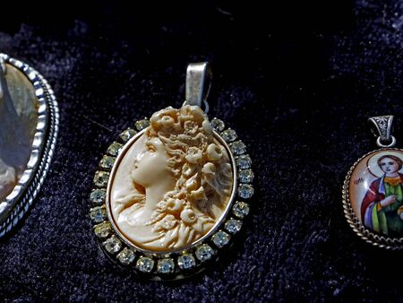 sale of old cameos, brooches, pendants at the flea market in Tbilisi near dry bridge