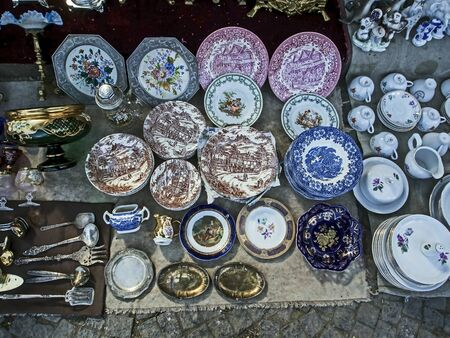 old porcelain plates with beautiful pictures at the flea market in Tbilisi
