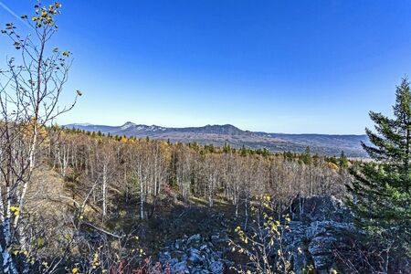 view of the Taganay ridge in autumn from the observation deck at the Black rock in the southern Urals Stok Fotoğraf