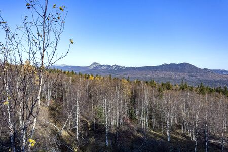 view of the Taganay ridge in autumn from the observation deck at the Black rock in the southern Urals Фото со стока