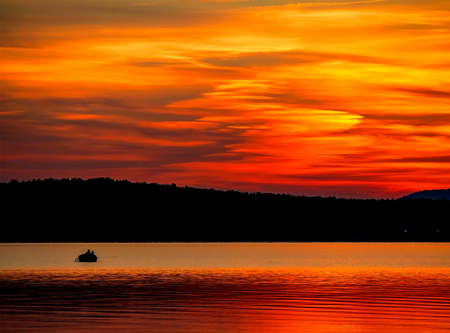 picturesque multicolored Golden sunset over a calm lake, summer, lake Uvildy, southern Urals