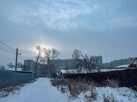 suburban landscape in winter during a snowfall in the evening, Southern Urals