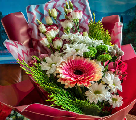 beautiful festive, well-designed bouquet of gerbera flowers, chrysanthemum, eustoma, alstroemeria and green thuja branches