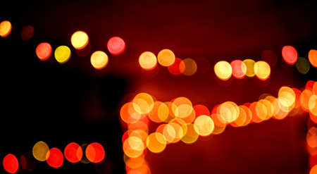 rows of unfocused multicolored lights on a dark background