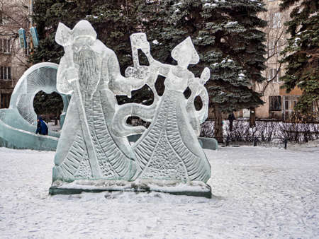 Santa Claus and Snow Maiden and ice figures at the New Year's playground, South Ural, Chelyabinsk