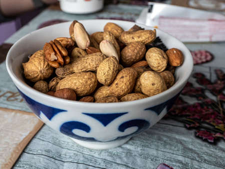 Assorted nuts in a colorful bowl on the table