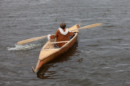 skiff: traditional boat of Siberia with the fisherman in national dress