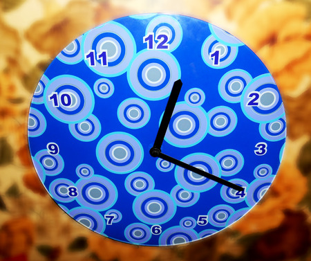 12 o'clock: Wall clock on blurred background