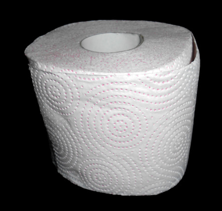 Toilet paper isolated on black photo