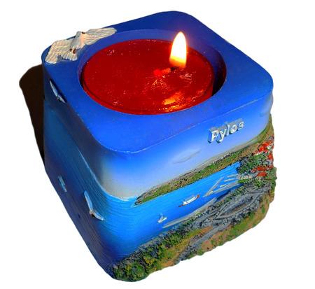 Souvenir tea light holder from Pylos, Greece, Isolated photo