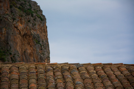 rooftiles: Looking at the cliff over the rooftiles at Monemvasia, Greece.
