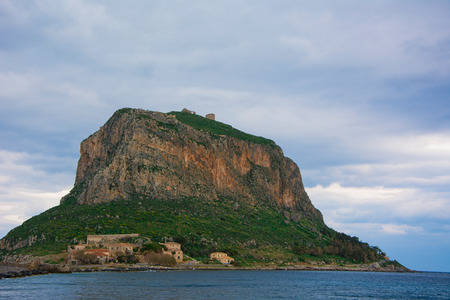 remnants: Distant view of the Monemvasia hill, with the castle remnants.