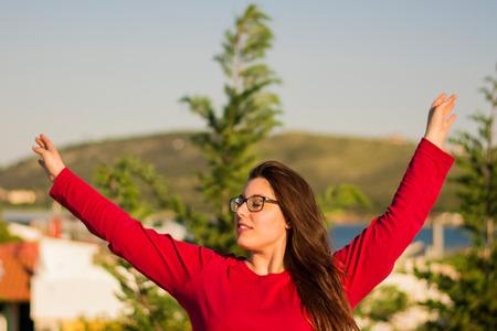 caucasian girl: A young beautiful caucasian girl stretching outdoors. Stock Photo