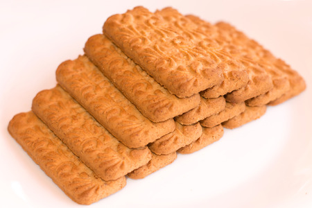 pyramid shape: Fifteen biscuits put on a pyramid shape, isolated on white background.