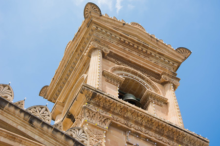 unharmed: Decoration of Mosta Dome in Malta. Mosta Dome is widely known because in World war 2, during the Nazi bombings a bomb that fell into the church was miraculusly not detonated, so anyone that took shelter there remained safe and unharmed.