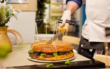 Cutting the king kong burger Stock Photo