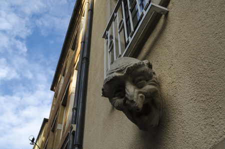 heads old building facade: Architecture detail in Luxembourg