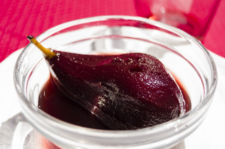 poached: Red wine poached pear Stock Photo