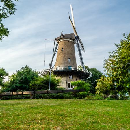 ALKMAAR, THE NETHERLANDS - AUGUST 25, 2013: De Groot (Molen van Piet) windmill in Alkmaar, the Netherlands, built in 1769 is now out of operation, being used as house and also as museum. Editorial