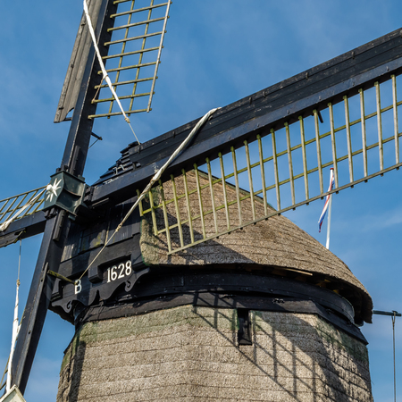 ALKMAAR, THE NETHERLANDS - AUGUST 25, 2013: Detail of a traditional Dutch windmills along the quay in Oudorp, Alkmaar (the Netherlands), built between 1627-1630.