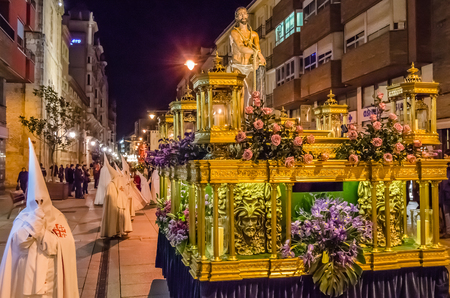 PALENCIA, SPAIN - MARCH 24, 2016: Traditional Spanish Holy Week (Semana Santa) procession on Holy Thursday night in the streets of Palencia (Castilla y Leon), Spain